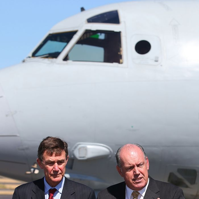 PERTH, AUSTRALIA - APRIL 08: Defence Minister David Johnston (R) responds to a reporters question together with Air Chief Marshal Angus Houston (Ret'd) during a press conference over the continuing search for missing Malaysia Airlines Flight MH370 at RAAF Base Pearce on April 8, 2014 in Perth, Australia. ACM Angus Houston advised the towed pinger by ADV Ocean Shield is still trying to re-locate the signals previously detected, which were believed to be consistent with aircraft black boxes. The airliner disappeared on March 8 with 239 passengers and crew on board and is suspected to have crashed into the southern Indian Ocean. (Photo by Paul Kane/Getty Images)