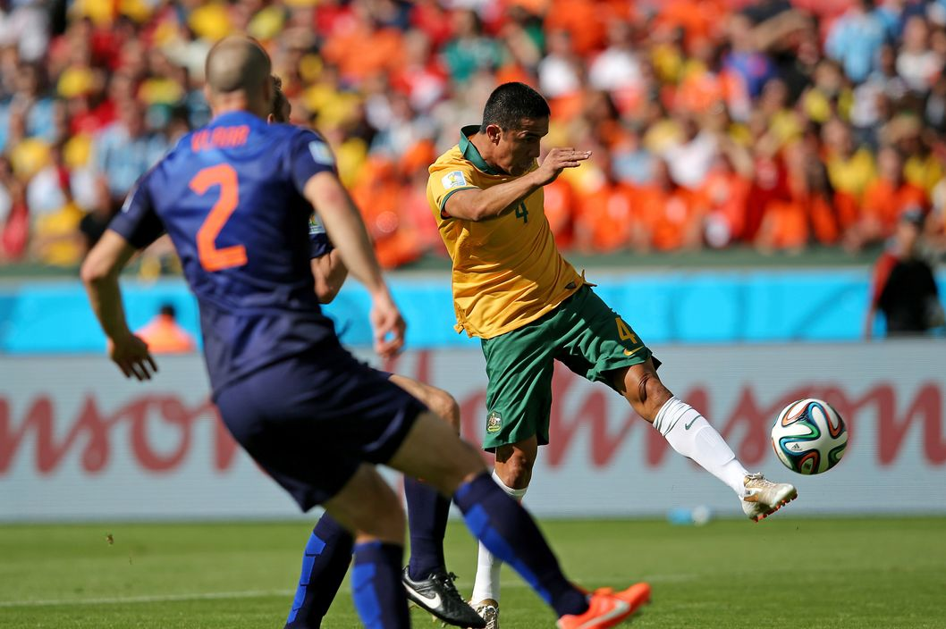 Tim Cahill of Australia shoots and scores his team's first goal during the 2014 FIFA World Cup Brazil Group B match between Australia and Netherlands at Estadio Beira-Rio on June 18, 2014 in Porto Alegre, Brazil