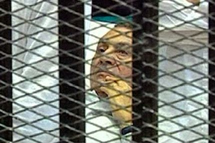 EDITORS NOTE THIS IS A RECROPPED VERSION OF LON868 - This video image taken from Egyptian State Television shows 83-year-old Hosni Mubarak laying on a hospital bed inside a cage of mesh and iron bars in a Cairo courtroom Wednesday Aug. 3, 2011 as his historic trial began on charges of corruption and ordering the killing of protesters during the uprising that ousted him. The scene, shown live on Egypt's state TV, was Egyptians' first look at their former president since Feb. 10, the day before his fall when he gave a defiant speech refusing to resign.   (AP Photo/Egyptian State TV)   EGYPT OUT