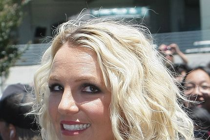 "Fox's ""The X-Factor"" Season 2 judge Britney Spears poses for photos after arriving at ORACLE Arena on June 18, 2012 in Oakland, California."
