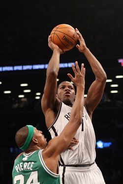 Joe Johnson #7 of the Brooklyn Nets gets the shot off over Paul Pierce #34 of the Boston Celtics at the Barclays Center on November 15, 2012 in the Brooklyn borough of New York City.