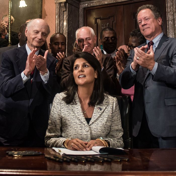 South Carolina Gov. Nikki Haley receives applause after signing a bill to remove the Confederate battle flag from the state house grounds July 9, 2015 in Columbia, South Carolina.