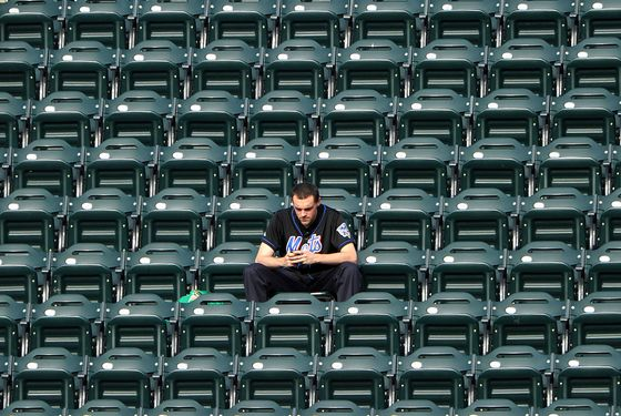 NEW YORK, NY - SEPTEMBER 08: An unidentified fan watches the game action between the Atlanta Braves and New York Mets at Citi Field on September 8, 2011 in the Flushing neighborhood of the Queens borough of New York City. (Photo by Christopher Pasatieri/Getty Images)