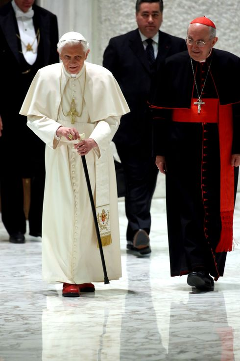 Pope Benedict XVI, flanked by cardinal Agostino Vallini, arrives at the Paul VI Hall for a meeting with parish priests of  Rome's diocese on February 14, 2013 in Vatican City, Vatican. The Pontiff will hold his last weekly public audience on February 27 at St Peter's Square after announcing his resignation earlier this week.