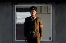 A North Korea soldier stands guard on the banks of the Yalu River which separates the North Korean town of Sinuiju from the Chinese border town of Dandong on the second anniversary of the death of former leader Kim Jong-Il, December 17, 2013. North Korean leader Kim Jong-Un presided over a major remembrance ceremony on the second anniversary of the death of his father and former leader Kim Jong-Il. The meeting came days after the shock execution of Kim Jong-Un's uncle and one-time political mentor, Jang Song-Thaek -- a purge that raised questions about the stability of the current regime in Pyongyang.
