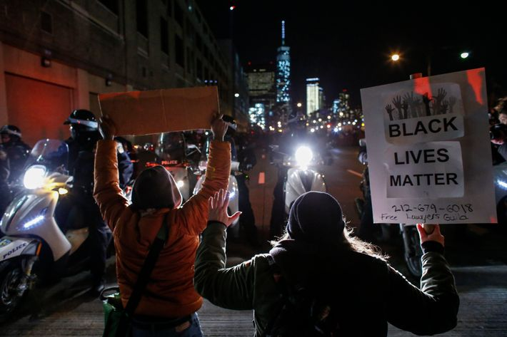 NEW YORK, NY - DECEMBER 4: Demonstrators watched by New York City police block the West Side Highway following yesterday's decision by a Staten Island grand jury not to indict a police officer who used a chokehold in the death of Eric Garner in July, on December 4, 2014 in New York City. The grand jury declined to indict New York City Police Officer Daniel Pantaleo in Garner's death. (Photo by Kena Betancur/Getty Images)