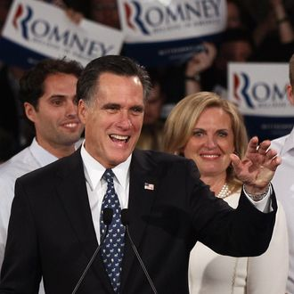 MANCHESTER, NH - JANUARY 10: Republican presidential candidate and former Massachusetts Gov. Mitt Romney (C) speaks during his primary night rally with members of his family following the