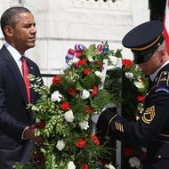 ARLINGTON, VA - MAY 28:  U.S. President Barack Obama (L) positions a commemorative wreath during a ceremony on Memorial Day at the Tomb of the Unknowns at Arlington National Cemetery on May 28, 2012 in Arlington, Virginia. For Memorial Day President Obama is paying tribute to military veterans past and present who have served and sacrificed their lives for their country.  (Photo by Mark Wilson/Getty Images)