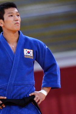 Korea's Cho Jun-Ho reacts after losing against Japan's Masashi Ebinuma during their men's -66kg contest match of the judo event at the London 2012 Olympic Games on July 29, 2012 at the ExCel arena in London. AFP PHOTO / FRANCK FIFE        (Photo credit should read FRANCK FIFE/AFP/GettyImages)