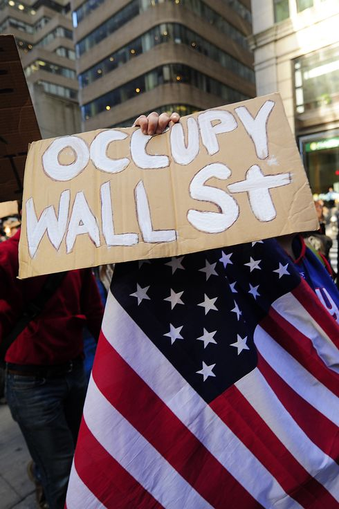 "Participants in the ""Occupy Wall Street"" demonstrate around Wall Street attempting to disrupt pedestrian flow for financial workers to get to work, in New York, September 19, 2011. Hundreds of demonstrators, who descended on Lower Manhattan on Saturday with the aim of staying at least until the open of the New York Stock Exchange on Monday, had planned to turn the area into an ""American Tahrir Square."" AFP PHOTO/Emmanuel Dunand (Photo credit should read EMMANUEL DUNAND/AFP/Getty Images)"