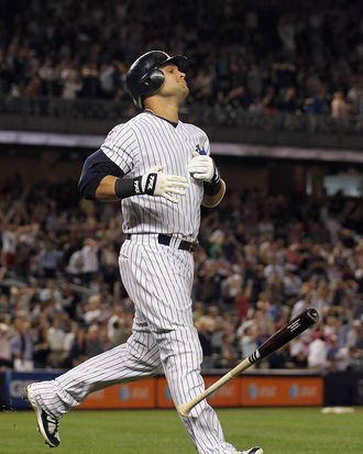 Nick Swisher #33 of the New York Yankees reacts after his hit in the ninth inning with bases loaded was caught on the warning track ending the game against the Oakland Athletics on August 23, 2011 at Yankee Stadium.