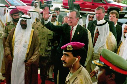 KUWAIT, KUWAIT - APRIL 15:  Former U.S. President George Bush (center-R) waves on his way to attend a special session in the Kuwaiti Parliament 15 April 1993. At (L) in the foreground is Kuwait Prime Minister Saad al Abdalla.  (Photo credit should read RAED QUTANIA/AFP/Getty Images)