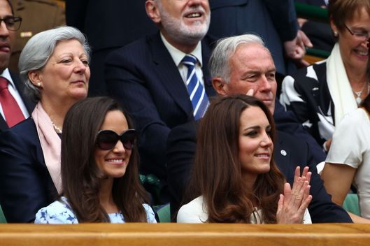 Pippa Middleton (L) and Catherine, Duchess of Cambridge sit in the Royal Box during the Gentlemen's Singles final match between Roger Federer of Switzerland and Andy Murray of Great Britain on day thirteen of the Wimbledon Lawn Tennis Championships at the All England Lawn Tennis and Croquet Club on July 8, 2012 in London, England.