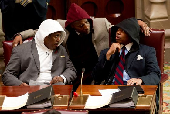 Sen. Kevin Parker, D-Brooklyn, left, Sen. Bill Perkins, D-New York, center, and Sen. Eric Adams, D-Brooklyn, wear hooded sweatshirts during session in the Senate Chamber in Albany, N.Y., on Monday, March 26, 2012. The senators wore the sweatshirts to protest the shooting death of Florida teen Trayvon Martin by a neighborhood watch volunteer. (AP Photo/Mike Groll)
