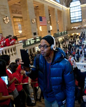 Apple Inc. employees greet customers at the opening of the new Grand Central Station location in New York, U.S., on Friday, Dec. 9, 2011.