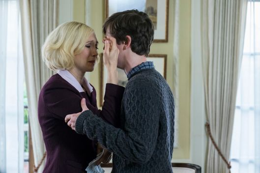 Vera Farmiga as Norma, Freddie Highmore as Norman.