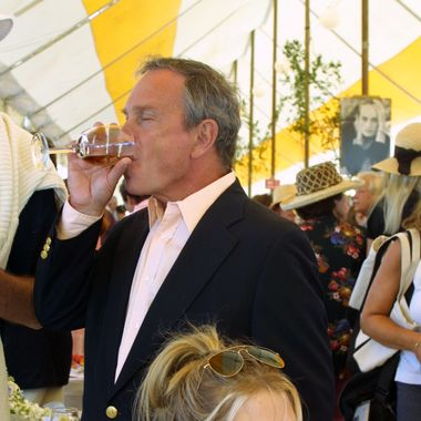 Michael Bloomberg drinks wine.