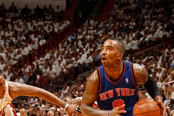 MIAMI, FL - MAY 09:  J.R. Smith #8 of the New York Knicks drives to the basket against Mario Chalmers #15 of the Miami Heat in Game Five of the Eastern Conference Quarterfinals during the 2012 NBA Playoffs on May 9, 2012 at American Airlines Arena in Miami, Florida. NOTE TO USER: User expressly acknowledges and agrees that, by downloading and or using this photograph, User is consenting to the terms and conditions of the Getty Images License Agreement. Mandatory Copyright Notice: Copyright 2012 NBAE  (Photo by Issac Baldizon/NBAE via Getty Images)