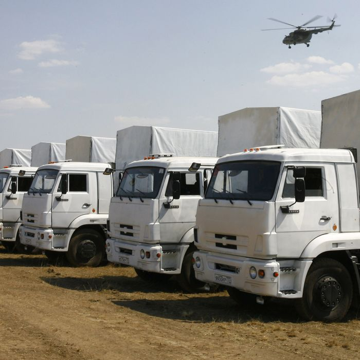 Trucks from a Russian humanitarian convoy are parked on a field outside the town of Kamensk-Shakhtinsky in the Rostov region, some 30kms from the Russian-Ukrainian border, Russia, on August 14, 2014. A massive Russian