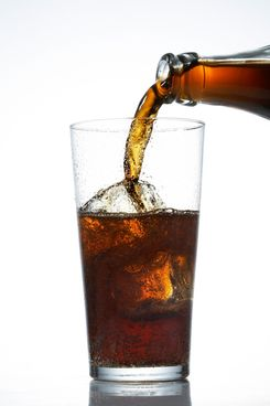 Pouring a glass of cola