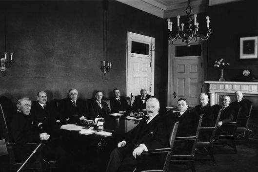 15th February 1921:  American president Woodrow Wilson (1856 - 1924) and his Cabinet, White House, Washington, D.C. L-R (around table): President Wilson, David Houston, Mitchell Palmer, Josephus Daniels, Edwin Meredith, William Wilson, Joshua Alexander, John Payne, Albert Burleson, Newton Baker and Bainbridge Colby.  (Photo by Hulton Archive/Getty Images)