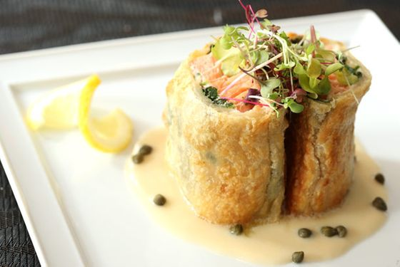 Farm-raised salmon wrapped in puff pastry, with Meyer lemon-caper aioli