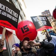 Protesters march through the streets demanding a raise on the minimum wage to $15 per hour on December 4, 2014 in New York, United States. The movement, driven largely by fast food workers, has risen in prominence in the past year; today's protests were also joined by demonstrators angry at the Grand jury verdict to not indict the police officer who killed Eric Garner in July, 2014.