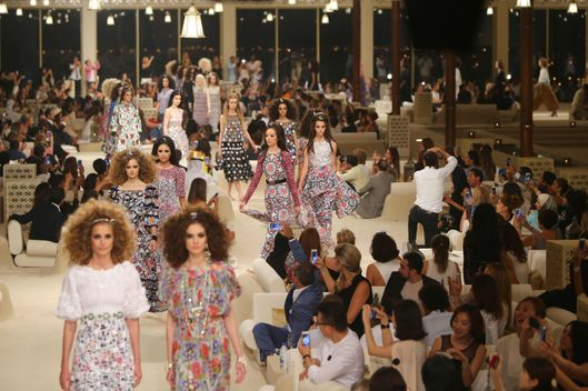 Models display outfits from the Chanel 2015 Cruise runway collection at The Island in Dubai, a man made island in the shape of a palm tree, on May 13, 2014.  Bruno Pavlovsky, chairman of Chanel fashion, explained the location as a true travel destination, and evokes the spirit of Cruise.    AFP PHOTO /MARWAN NAAMANI        (Photo credit should read MARWAN NAAMANI/AFP/Getty Images)
