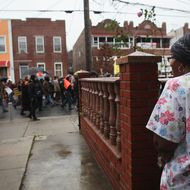 "NEW YORK, NY - DECEMBER 06:  Community activists and over two hundred members of the Occupy Wall Street movement march in the impoverished community of East New York to draw attention to foreclosed homes in the community on December 6, 2011 in the Brooklyn borough of New York City. The group said they would occupy a home and would hand the property over to a homeless family. In what organizers are describing as a ""new frontier"" for the movement, thousands of other Occupy Wall street protesters around the country participated in similar actions. (Photo by Spencer Platt/Getty Images)"