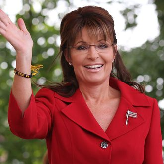 MANCHESTER, NH - SEPTEMBER 05: Former Alaska governor Sarah Palin waves during a Tea Party Express rally on September 5, 2011 in Manchester, New Hampshire. Hundreds of people attended the rally that is part of the 'Reclaiming America' bus tour traveling through 19 states and visiting 29 cities before arriving in Tampa, Florida for a presidential debate co-sponsored by CNN on September 12. (Photo by Justin Sullivan/Getty Images)