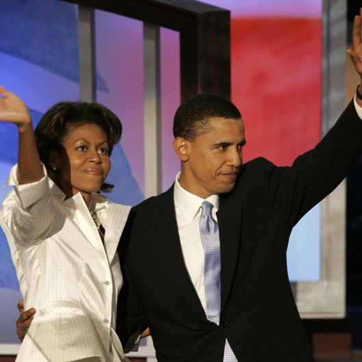 Keynote speaker Barack Obama, candidate for US Senate - Illinois, and his wife, Michelle, wave to the delegates during the DNC at the FleetCenter Tuesday, July 27, 2004.