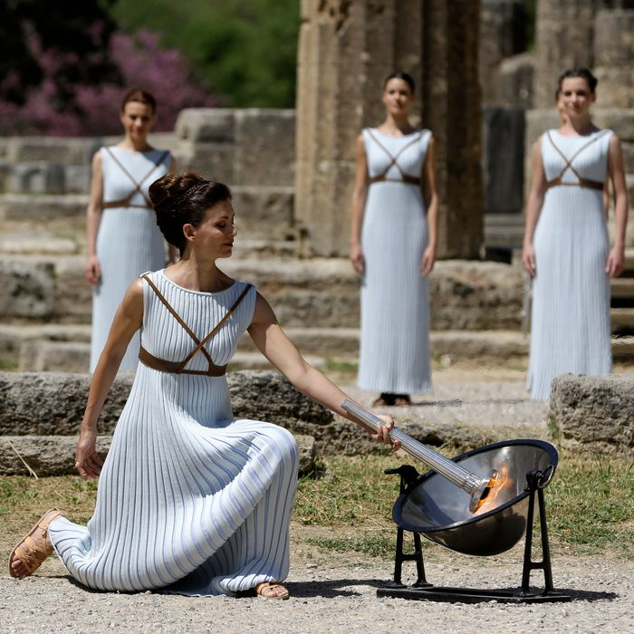 Katerina Lehou lights the Olympic torch at the temple of Hera.