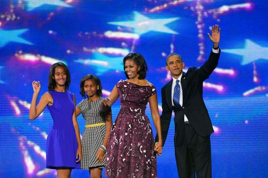 Sasha, Malia, Michelle and President Barack Obama wave to the delegation at the 2012 Democratic National Convention in Times Warner Cable Arena Thursday, September 6, 2012 in Charlotte, North Carolina. (Harry E. Walker/MCT)