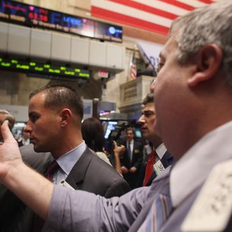 NEW YORK, NY - NOVEMBER 01: Traders work on the floor of the New York Stock Exchange before the closing bell on November 1, 2011 in New York City. U.S. stocks and global markets fell sharply Tuesday following news that Greece's prime minister has called for an unexpected public vote to approve Europe's debt deal. The Dow Jones industrial average (INDU) finished 297 points lower. Leaders of France and Germany, the architects of the Greek rescue plan, have scheduled an emergency meeting after Greek Prime Minister George Papandreou called for the referendum. (Photo by Spencer Platt/Getty Images)