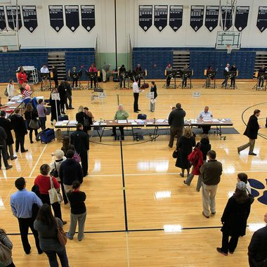 Voters stand on line at the polls November 6, 2012 in Columbus, Ohio. U.S. citizens go to the polls today to vote in the election between Democratic President Barack Obama and Republican nominee former Massachusetts Gov. Mitt Romney.