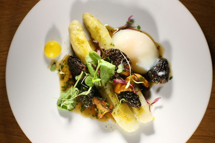 At Aldea, George Mendes pairs morels with white asparagus and a soft-poached hen egg.