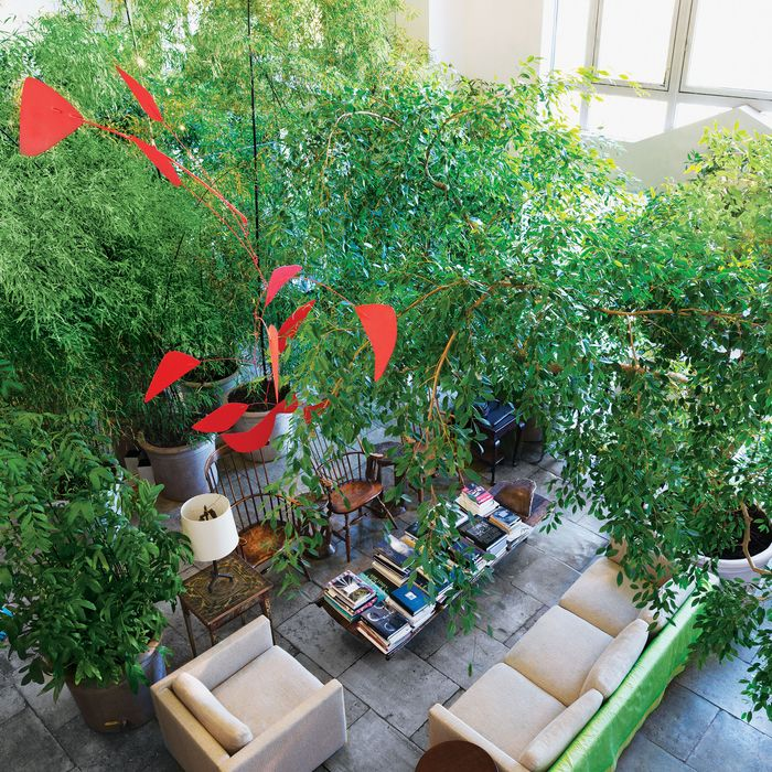 A Calder mobile hangs above the lush living room.