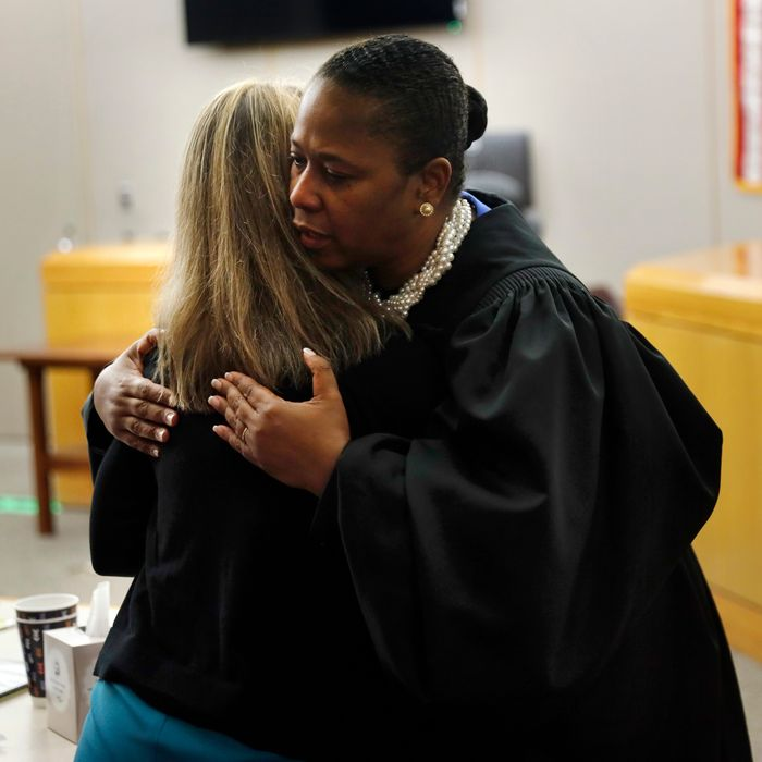 State District Judge Tammy Kemp gives former Dallas Police Officer Amber Guyger a hug before Guyger leaves for jail, Wednesday, Oct. 2, 2019, in Dallas.