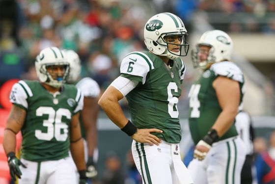 Mark Sanchez #6 of the New York Jets looks to the bench for the call in the first half against the Miami Dolphins on October 28, 2012 at MetLife Stadium in East Rutherford, New Jersey.