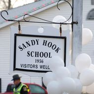 Police guard the entrance to the Sandy Hook School on December 15, 2012 in Newtown, Connecticut. The residents of an idyllic Connecticut town were reeling in horror from the massacre of 20 small children and six adults in one of the worst school shootings in US history. The heavily armed gunman shot dead 18 children inside Sandy Hook Elementary School, said Connecticut State Police spokesman Lieutenant Paul Vance. Two more died of their wounds in hospital.