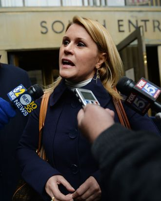 Canadian actress Genevieve Sabourin, accused of stalking actor Alec Baldwin, talks to the media outside Manhattan Criminal Court November 12, 2013 in New York.