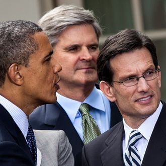 House Majority Leader Representative Eric Cantor (R-VA) (R) and others listen as US President Barack Obama speaks with guests after a bill signing in the Rose Garden of the White House April 5, 2012 in Washington, DC. Joined by Democratic and Republican lawmakers President Obama signed HR 3606, the