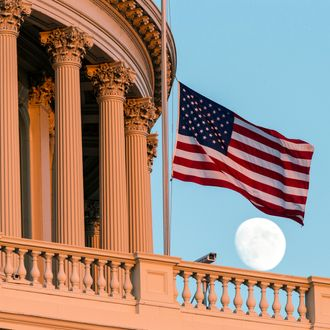 The American flag flies at half-staff over the U.S. Capitol at sunset following the shooting at the Washington Navy Yard, Monday, Sept. 16, 2013, in Washington. (AP Photo/J. Scott Applewhite)