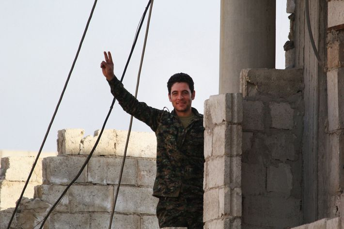 A man flashes victory sign in Kobani, Syria on January 27, 2015 after it has been freed from Islamic State of Iraq and the Levant (ISIL).