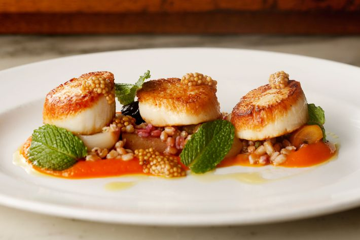 Diver scallops with carrots, faro, mint, and pickled mustard seeds.