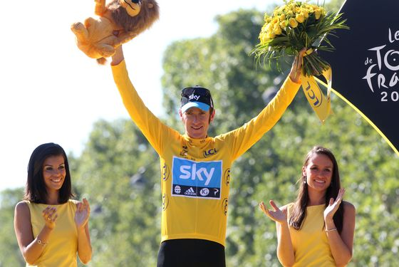 PARIS, FRANCE - JULY 22: Bradley Wiggins of Great Britain and Sky Procycling receives the last yellow jersey during the trophy ceremony, after the twentieth and final stage of the 2012 Tour de France, from Rambouillet to the Champs-Elysees on July 22, 2012 in Paris, France. (Photo by John Berry/Getty Images)