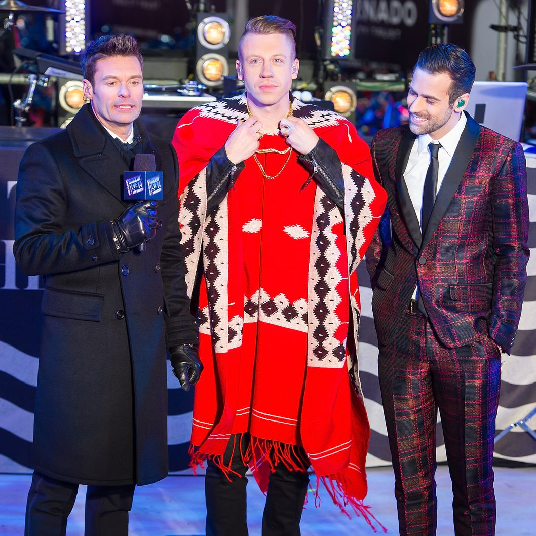 NEW YORK, NY - DECEMBER 31:  (L-R) Ryan Seacrest, Macklemore and Ryan Lewis attend Dick Clark's New Year's Rockin' Eve with Ryan Seacrest 2014 in Times Square on December 31, 2013 in New York City.  (Photo by Michael Stewart/WireImage)