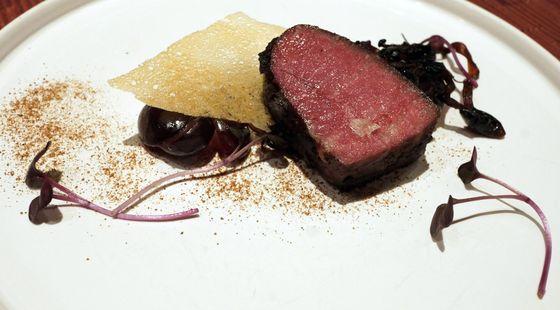 Flatiron steak with bone-marrow tart.