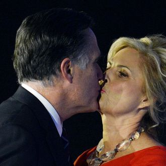 US Republican presidential candidate Mitt Romney kisses his wife Ann after conceding defeat to President Barack Obama on November 7, 2012 in Boston. Obama swept to re-election, forging history again by transcending a slow economic recovery and the high unemployment which haunted his first term to beat Romney.