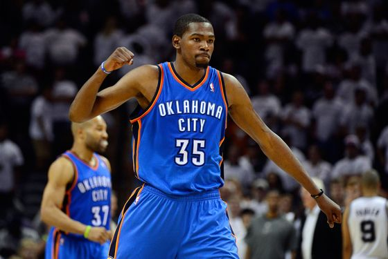 SAN ANTONIO, TX - JUNE 04:  Kevin Durant #35 of the Oklahoma City Thunder celebrates late in the game after hit a free throw against the San Antonio Spurs in Game Five of the Western Conference Finals of the 2012 NBA Playoffs at AT&T Center on June 4, 2012 in San Antonio, Texas. NOTE TO USER: User expressly acknowledges and agrees that, by downloading and or using this photograph, user is consenting to the terms and conditions of the Getty Images License Agreement.  (Photo by Ronald Martinez/Getty Images)